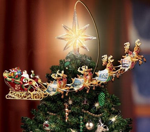 Picture 6 Thomas Kinkade does it again with a Revolving Christmas Tree Topper that goes over the top, literally
