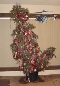 decorating the tree with the copter LIGHTSPEED Phone Controlled i Helicopter, yup, theres an app for that